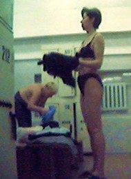 Sexy lady bares it all in a public locker room
