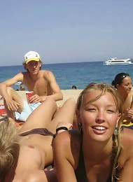 Slim teen with perky boobs naked at a nudist beach