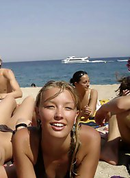 Curvy young nudist lets the sun kiss her body