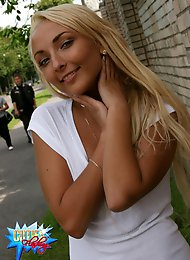 Blonde beauty shows her perfect body in the street