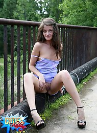 Sexy doll flashes her shaven pinkie off the bridge