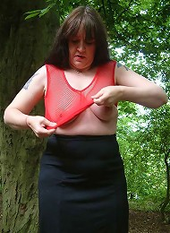 MILF changing her clothes in a public park